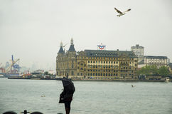 Istanbul steamboat pier people walking in the rain. Stock Photography