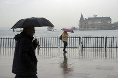 Istanbul steamboat pier people walking in the rain. Royalty Free Stock Photo