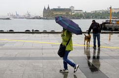 Istanbul steamboat pier people walking in the rain. Stock Photo