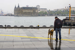 Istanbul steamboat pier people walking in the rain. Royalty Free Stock Photography