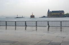 Istanbul steamboat pier rain and Haydarpasa train station building. Strait of Istanbul, Kadikoy Pier, ferries are the most popular form of public transport in stock image