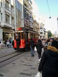 Istanbul streets with famous red tram and walking people stock photos