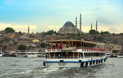 Istanbul sunset. Istanbul New mosque (Yeni Camii) in sunset;Boats on the Bosphorus river Royalty Free Stock Photography