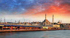 Istanbul at sunset with mosque and bridge Royalty Free Stock Photos