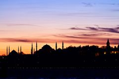 Istanbul at sunset. Istanbul, Sarayburnu Silhouette. Landmarks in the distance are Blue Mosque, Hagia Sophia and Topkapi Palace Stock Photos