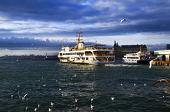 Istanbul throat historic Haydarpasa train station and the ferry. Royalty Free Stock Photography