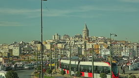 Istanbul traffic. ISTANBUL, TURKEY - SEPTEMBER 26, 2013 Traffic and passers-by in the square with the view to the Beyoglu district stock video footage