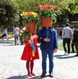 Istanbul, Turkey - April 20, 2016: istanbul tulip festival at sultanahmet and one tulip lover couple and they put tulip on their h. Istanbul tulip festival at royalty free stock photography