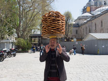 Istanbul, Turkey - April 24 2015.  A man selling pretzels on the streets of Istanbul. on April 24, 2015 in Istanbul, Turkey. Istanbul, Turkey - April 24 2015 Stock Photo