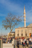 ISTANBUL, TURKEY - APRIL 27, 2015: people walking at Eminonu quarter of Istanbul near Yeni Camil New Mosque Royalty Free Stock Images