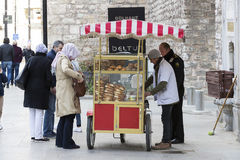Street sales of traditional Turkish bagels Simit, are on the streets of Istanbul in Turkey Royalty Free Stock Photos