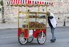 Street sales of traditional Turkish bagels Simit, are on the streets of Istanbul in Turkey Stock Photography