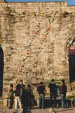 Istanbul, Turkey - April 5, 2012: Turkish citizens playing to shoot balloons at balloons on a wall of the old part of the city of