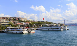 ISTANBUL, TURKEY, AUGUST 24, 2015: Cruisers line up. On the golden horn,Istanbul in the background Stock Photos