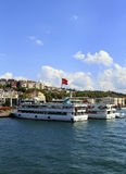 ISTANBUL, TURKEY, AUGUST 24, 2015: Cruisers line up. On the golden horn,Istanbul in the background Stock Images