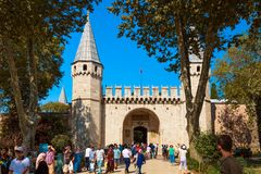 Istanbul, Turkey - August, 2018: Historical Topkapi Palace in Istanbul with tourists during summer sunny day. Gate of Salutation royalty free stock photography
