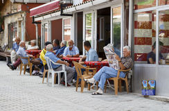 ISTANBUL, TURKEY, AUGUST 24, 2015: Old turkish men sit at cafe t Stock Photos