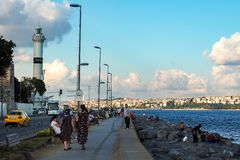ISTANBUL, TURKEY - AUGUST 21, 2018: people walk along promenade Bosphorus royalty free stock photos