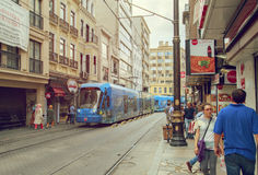 ISTANBUL,TURKEY-August 22:People walking on Street with modern tram Royalty Free Stock Photos