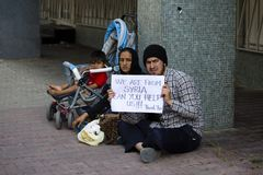 Refugees from Syria are asking for help on the street in Istanbul, Turkey Stock Image