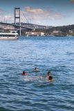 Ortakoy, Istanbul, Turkey. Istanbul, Turkey - August 25, 2017: View from Ortakoy coast by the Bosphorus, Istanbul. Kids swimming in the waters of Bosphorus on a Stock Photo