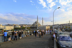 ISTANBUL, TURKEY - August 23, 2015: walking people and fishermen Royalty Free Stock Images