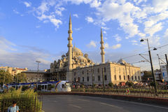 ISTANBUL, TURKEY - August 23, 2015: Yeni Cami ( New Mosque ) and modern tram Royalty Free Stock Photos
