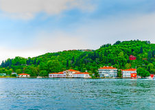 In Istanbul in Turkey. Beautiful old houses across Bosphorus channel at Istanbul Turkey Royalty Free Stock Images
