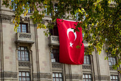 Istanbul, Turkey. The big turkish flag. On the wall of classic style building royalty free stock images