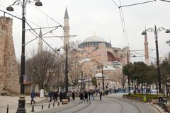 Tourists visiting the Hagia Sophia in front of Sultan Ahmed Park. ISTANBUL,TURKEY - DEC 29 : Tourists visiting the Hagia Sophia in front of Sultan Ahmed Park on royalty free stock photos