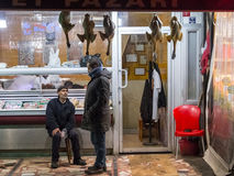 ISTANBUL, TURKEY - DECEMBER 30, 2015: Butcher discussing with a client in front of his shop on the European side of the city in th stock images