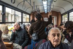 Crowded interior of an istanbul tram, packed with Turkish people, during rush hour on the Asian side. ISTANBUL, TURKEY - DECEMBER 30, 2015: Crowded interior of royalty free stock photos