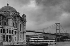 Istanbul, Turkey. 06-December-2018. Scenic black and white photo of Ortakoy mosque and bridge during a cloudy day stock image