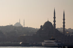 ISTANBUL, TURKEY - DECEMBER 27, 2015: Silhouette of Eminonu Mosque and Blue Mosque at Sunset in winter Royalty Free Stock Image