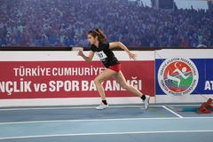 Turkish Athletic Federation Indoor Athletics Record Attempt Race. ISTANBUL, TURKEY - DECEMBER 23, 2017: Undefined athlete running during Turkish Athletic Stock Images