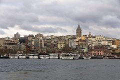 Istanbul, Turkey-December 15, 2015 -View of the Galata tower. And  pleasure boat of the strait of the Turkish city of Istanbul.cr2 Royalty Free Stock Image