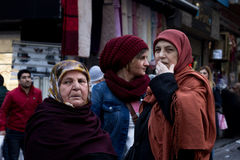ISTANBUL, TURKEY - DECEMBER 28, 2015: Women wearing islamic headscarf of various ages in the streets of Istanbul. Picture of three different women, of different stock photo