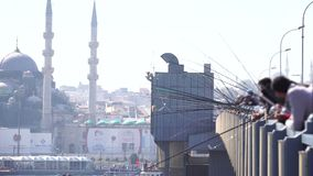 Istanbul Turkey Eminonu Coastline. With fisherman scene stock video footage