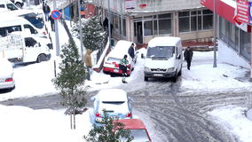 ISTANBUL, TURKEY - FEBRUARY 2015: Car stuck, spinning, snowy streets stock footage