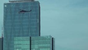 Helicopter taking off from the top of a skyscraper, istanbul, Turkey