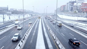 ISTANBUL, TURKEY - FEBRUARY 2015: Highway traffic on snowy day stock video footage