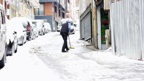 ISTANBUL, TURKEY - FEBRUARY 2015: manually cleaning streets from snow stock footage