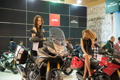 Istanbul, Turkey - February 28, 2015: 2015 model Aprilia Motorcycles with beautiful girls. Royalty Free Stock Image