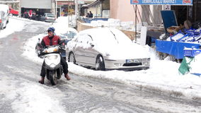 ISTANBUL, TURKEY - FEBRUARY 2015: scooter courier riding, snowy streets stock video footage