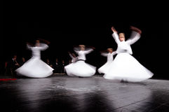ISTANBUL, TURKEY - FEBRUARY 02, 2012: Whirling mevlevi dervis in worship show Galata Istanbul. They are also known as the Whirling stock photography