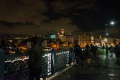 Istanbul, Turkey Fishermen on the Galata bridge. Galata or Beyoglu district of Istanbul at night, Turkey. This is one of the main stock image