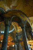 ISTANBUL, TURKEY: Hagia Sophia interior. Old metal chandelier between columns. Hagia Sophia is the greatest monument of Byzantine Culture royalty free stock images