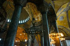 ISTANBUL, TURKEY: Hagia Sophia interior. Old metal chandelier between columns. Hagia Sophia is the greatest monument of Byzantine Culture royalty free stock photography