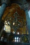 ISTANBUL, TURKEY: Hagia Sophia interior. Old metal chandelier between columns. Hagia Sophia is the greatest monument of Byzantine Culture stock photo