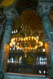 ISTANBUL, TURKEY: Hagia Sophia interior. Old metal chandelier with light bulbs between columns. Hagia Sophia is the greatest monument of Byzantine Culture stock photo